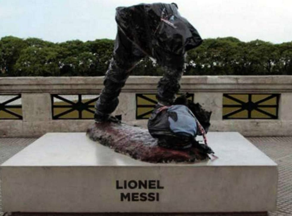 The statue of Lionel Messi after being vandalised
