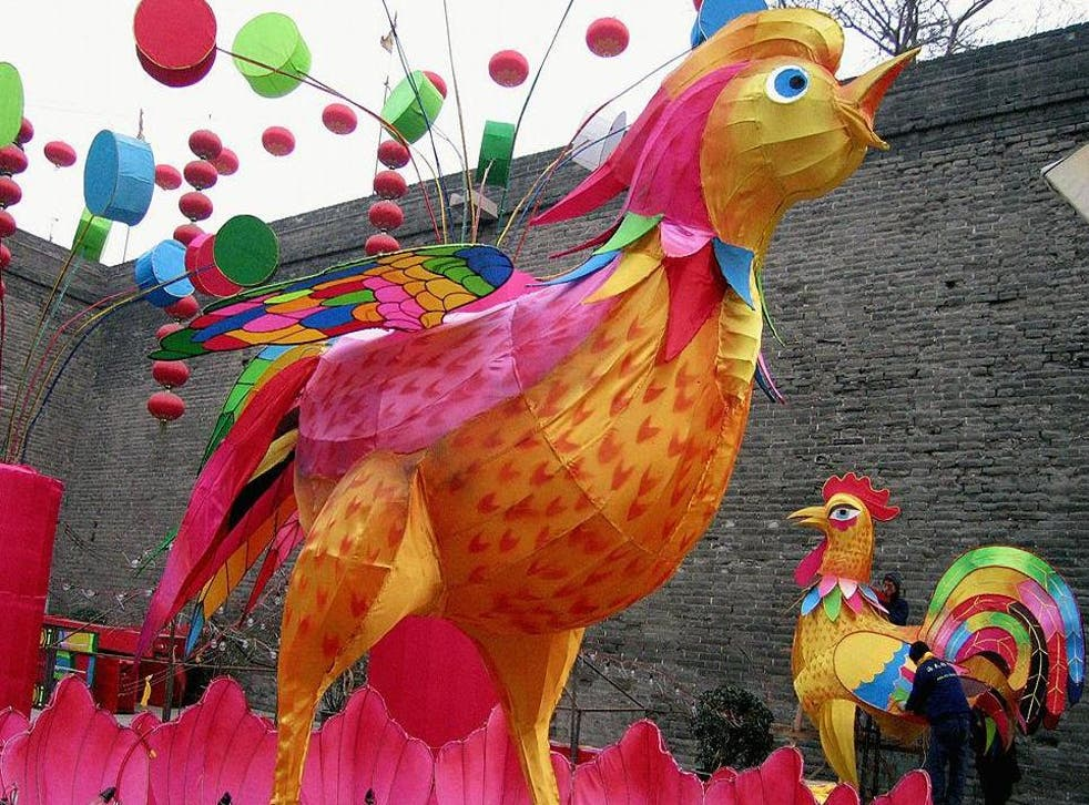 Festival decorations are taking shape as the Chinaprepares to welcome the Lunar Year of the Rooster(