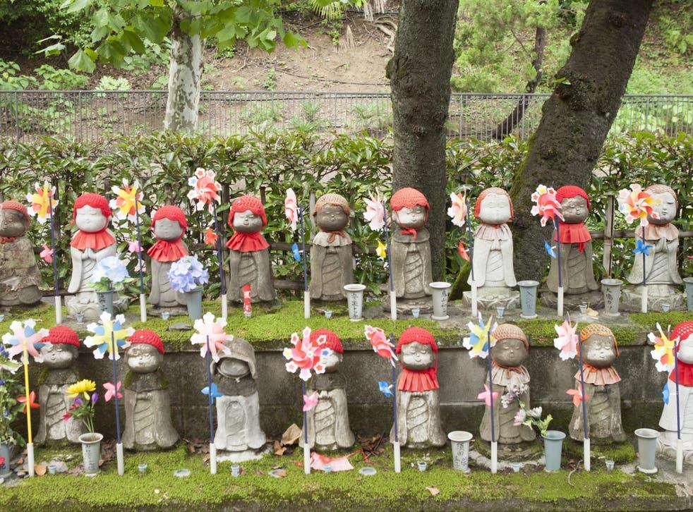 Jizo statues at the Zojoji temple in Japan