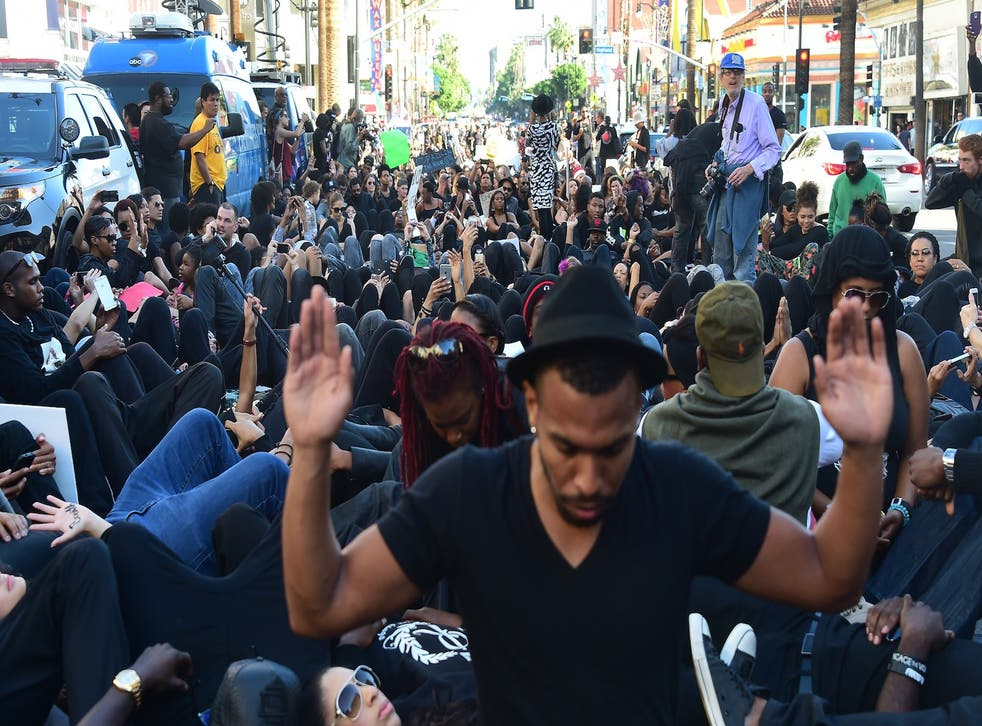 Protesters stage a sit-in in front of the Dolby Theater in Hollywood, California, on December 6, 2014. The group called BlackOutHollywood Against Police Brutality and its supporters, many dressed in black, marched along Hollywood Boulevard to protest against the deaths of unarmed African-American men at the hands of police officers in Los Angeles, New York and Ferguson, Missouri.