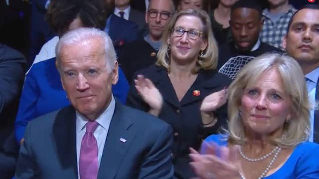 Joe Biden and Dr Jill Biden watch Barack Obama's farewell speech on 11 January. Obama called Biden his 'brother'
