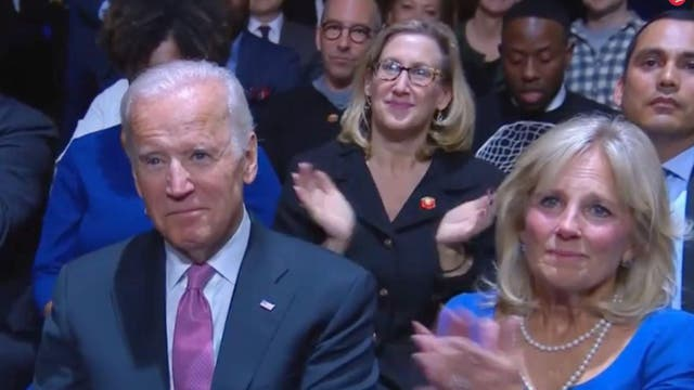 Joe Biden and Dr Jill Biden watch Barack Obama's farewell speech on 11 January. Obama called Biden his 'brother'