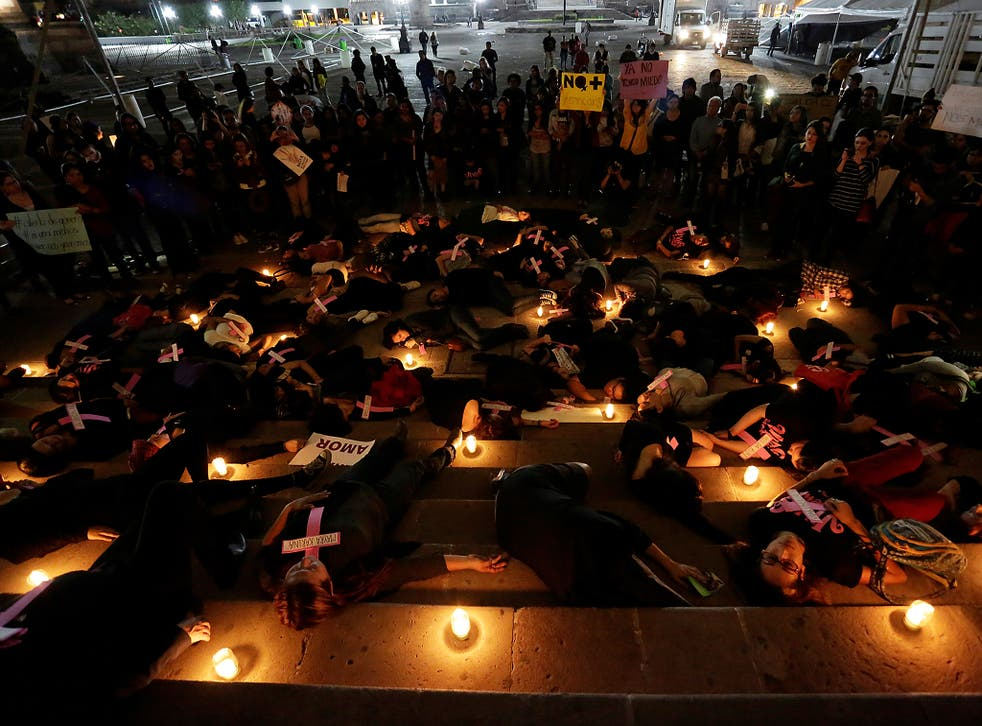 Women lie on the ground during a rally in Mexico against gender violence in November