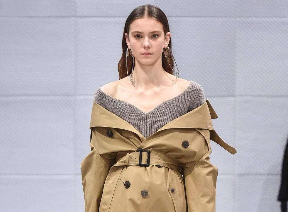 At Balenciaga the trench was worn off the shoulder and cinched at the waist