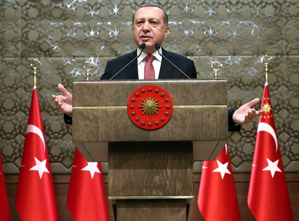 Turkey's President Recep Tayyip Erdogan addresses village administrators in Ankara, Turkey