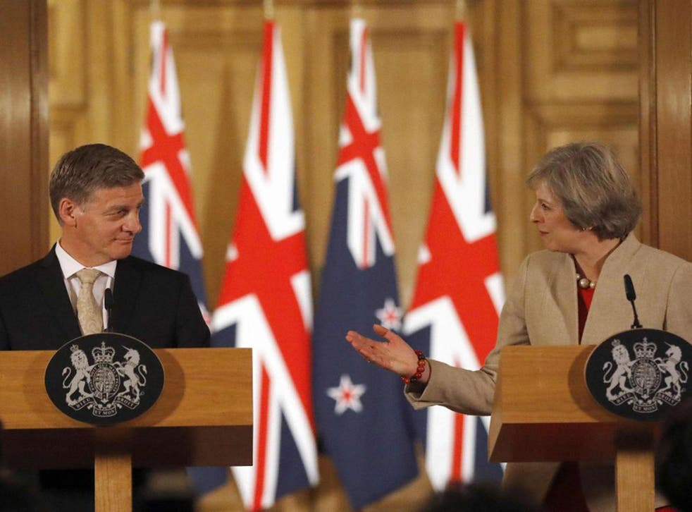 British Prime Minister Theresa May (R) and New Zealand Prime Minister Bill English give a press conference at 10 Downing Street in London
