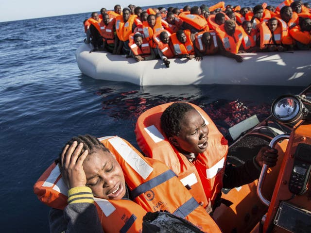 Women being rescued by the Aquarius humanitarian ship from a refugee boat in the Mediterranean in January