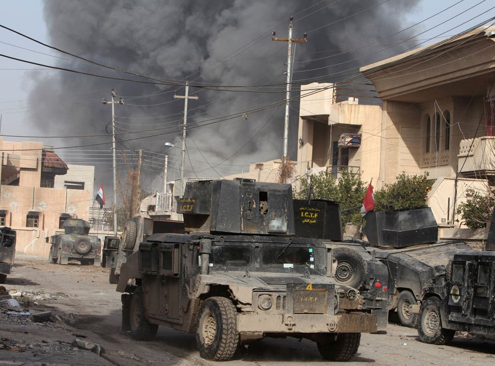 Smoke rises from an air strike during a battle with Isis militants in the Tahrer district of Mosul, Iraq, on 10 January