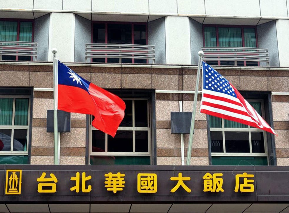 The national flags of Taiwan (L) and the US (R) hanging outside the Imperial Hotel Taipei in Taipei, Taiwan, 14 January 2017. Diplomatic relations between the United States and the Asian region are expected to change as US President-elect Donald Trump has said that the 'One China' policy on Taiwan is up for negotiation under his administration.