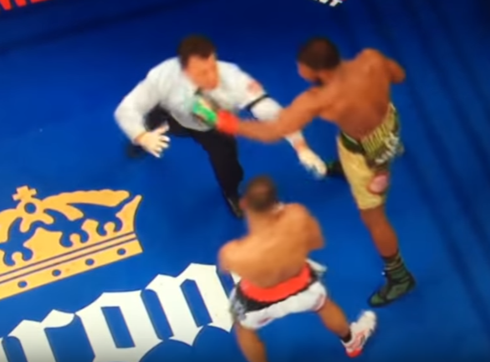 Referee Arthur Mercante Jr takes a left hook straight to the face