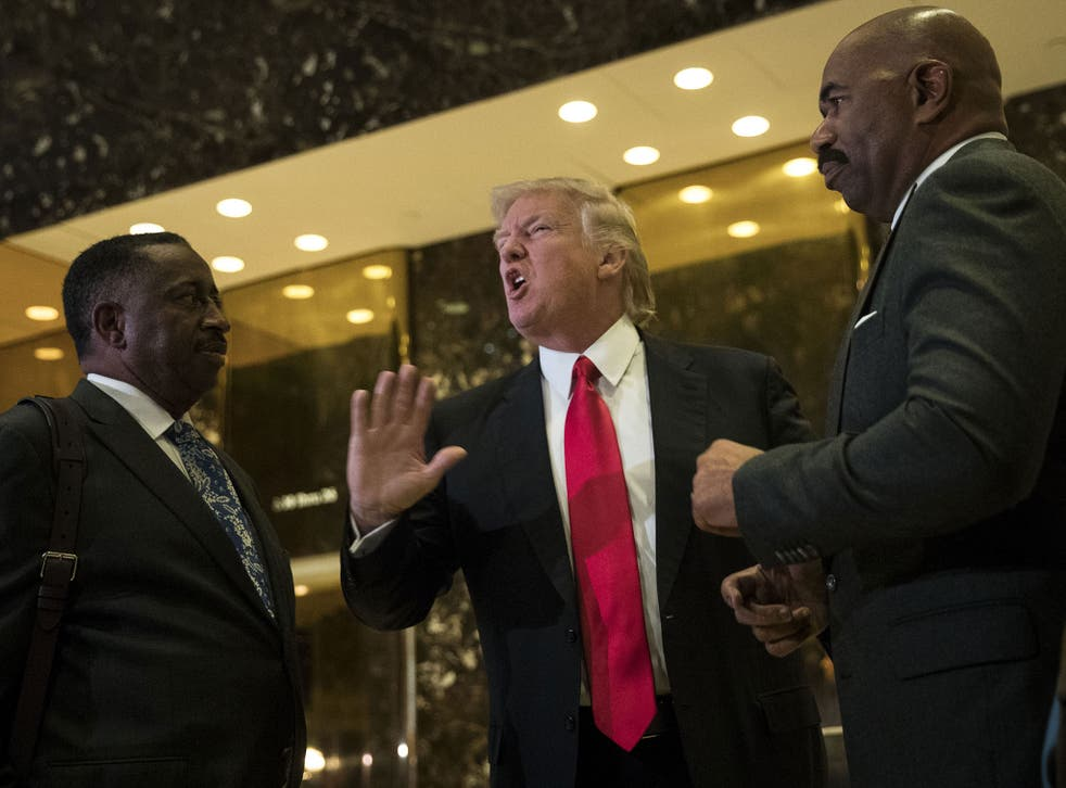 President-elect Donald Trump (C) and television personality Steve Harvey (R) speak to reporters after their meeting at Trump Tower on 13 January, 2017