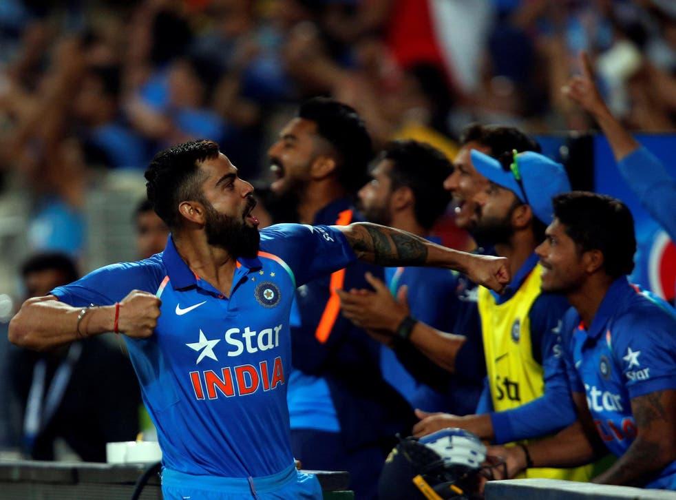 India's captain Virat Kohli celebrates after winning the match