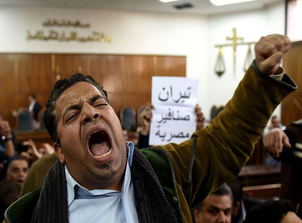 A man cheers a lower court ruling that Tiran and Sanafir belong to Egypt on December 19 2016