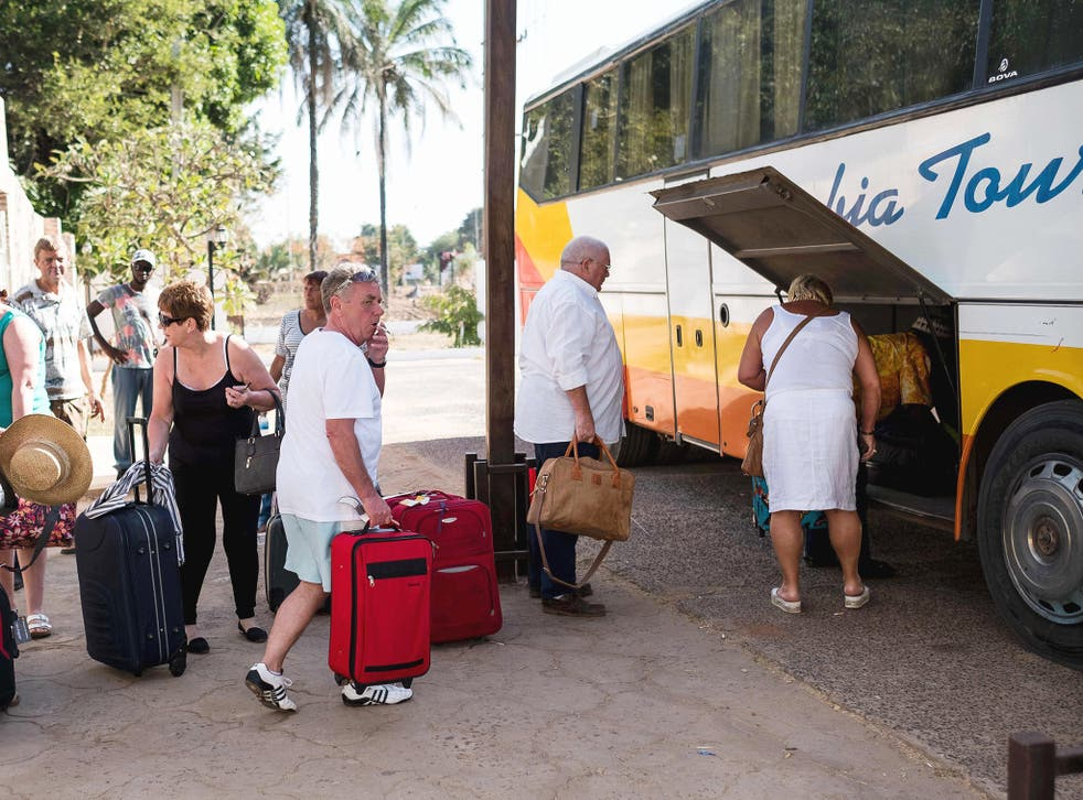 Tourists load luggage onto a bus in preparation to leave the Gambia after the British Government changed the travel advisory to amber due to the state of emergency issued by Gambian President Jammeh in Banjul, Gambia