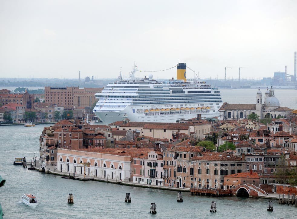 A cruise ship ploughs its way into Venice