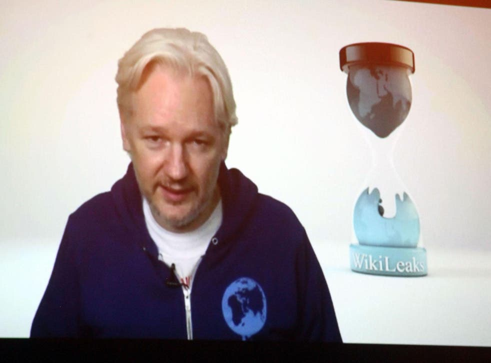 Wikileaks founder Julian Assange introduces M.I.A. via videolink from the Ecuadorian embassy in London at Terminal 5 on November 1, 2013 in New York City