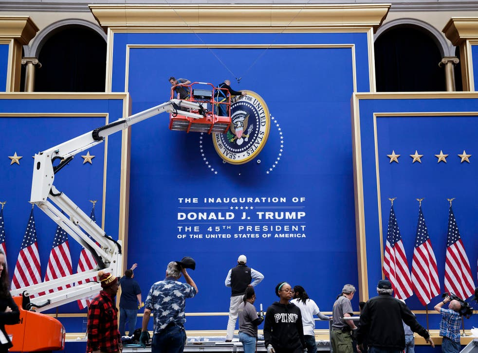 Workers assemble the stage for the Commander-in-Chief Ball at the National Building Museum