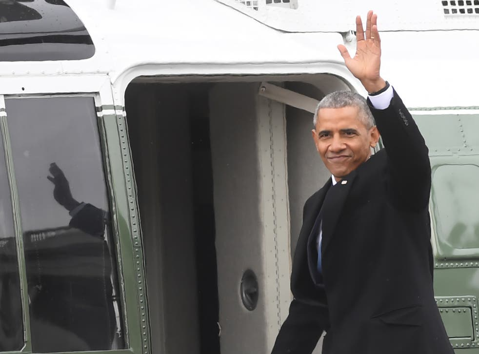 Barack Obama climbs aboard Marine One en route to Joint Base Andrews