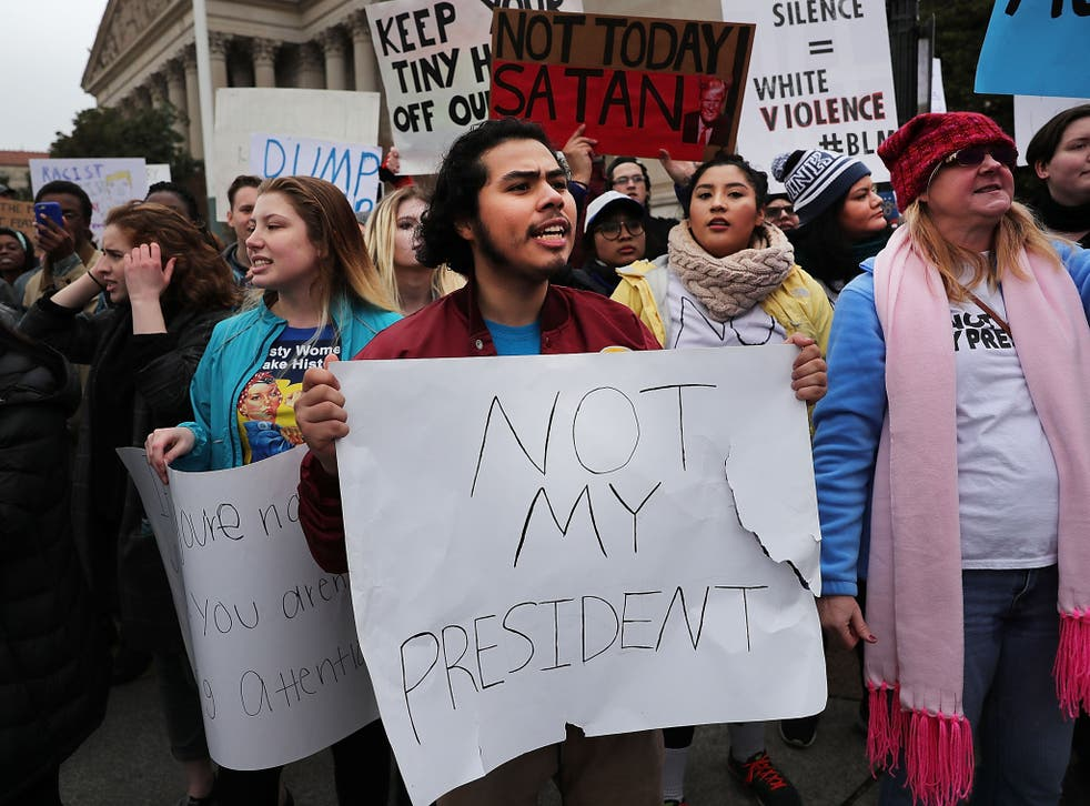 Anti-Trump protesters demonstrate near the National Mall