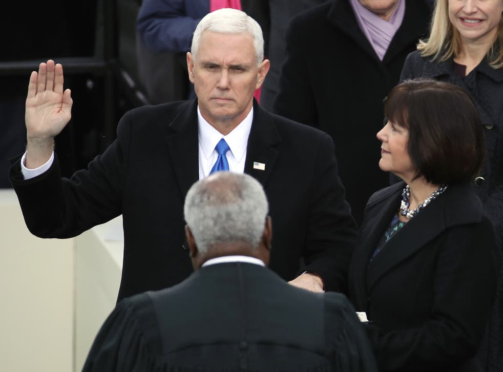Mike Pence takes the oath of office on the West Front of the US Capitol in Washington