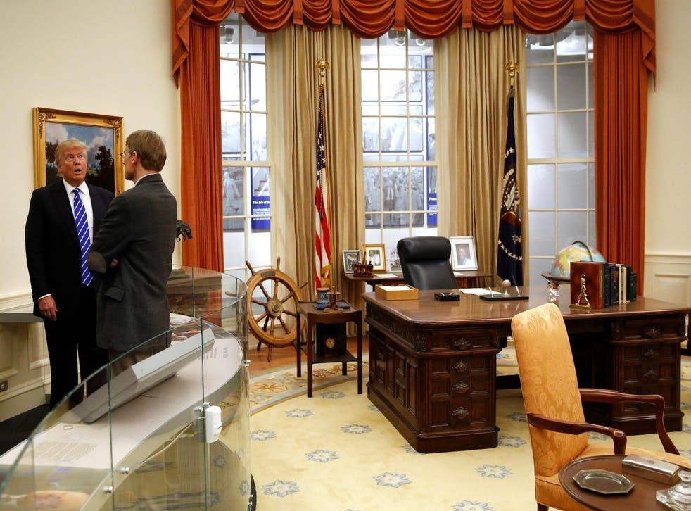 Republican presidential nominee Donald Trump views a replica of the Oval Office on a tour of the Gerald Ford Presidential Museum in Grand Rapids, Michigan, U.S. September 30, 2016