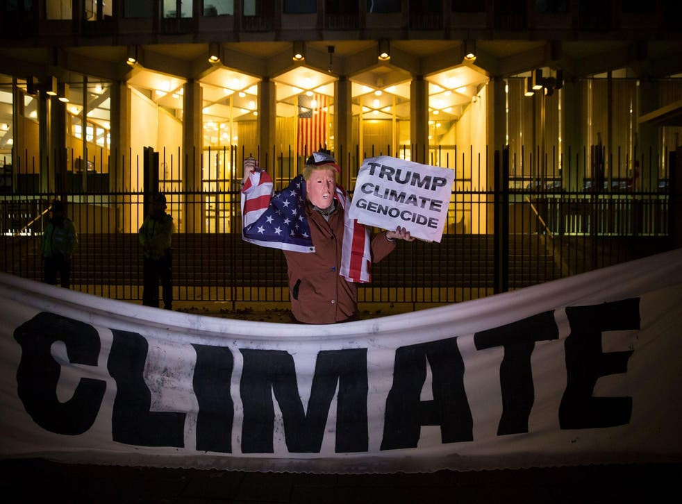 Donald Trump's views on climate change have led to protests around the world, including this one at the US Embassy in London