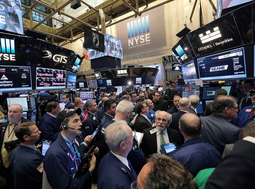 Traders gather on the floor of the New York Stock Exchange (NYSE) in Manhattan, New York City