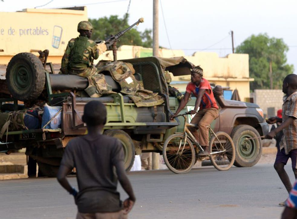 Senegalese soldiers patrol the area close to the Senegal-Gambia border near Karang on Friday