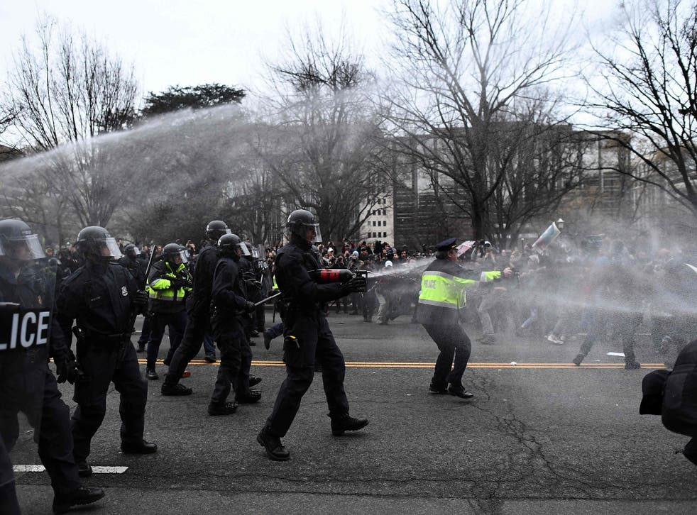 Police pepper spray anti-Trump protesters during clashes with police in Washington, DC, on January 20, 2107