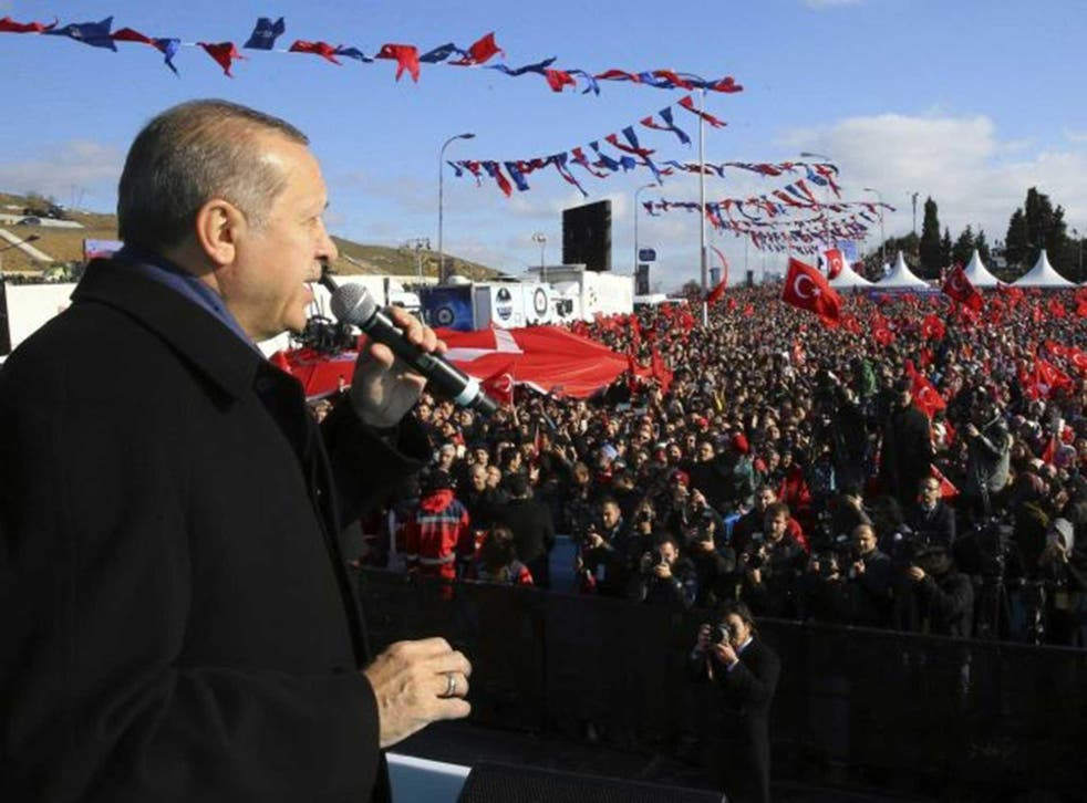 President Erdogan addresses supporters in Istanbul, hours after the parliamentary vote passed
