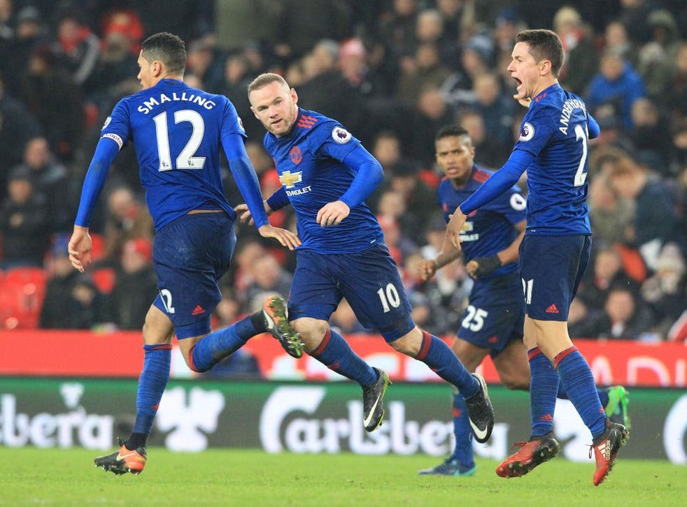 Wayne Rooney celebrates scoring his club-record 250th goal for Manchester United