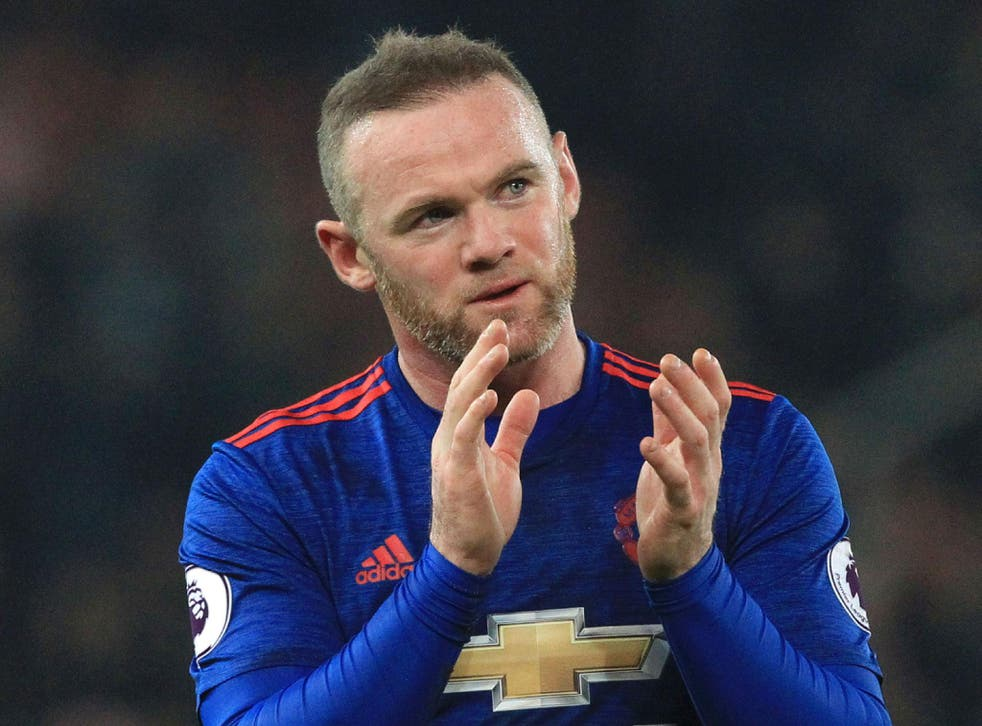 Wayne Rooney applauds the Manchester United fans after his record-breaking 250th goal