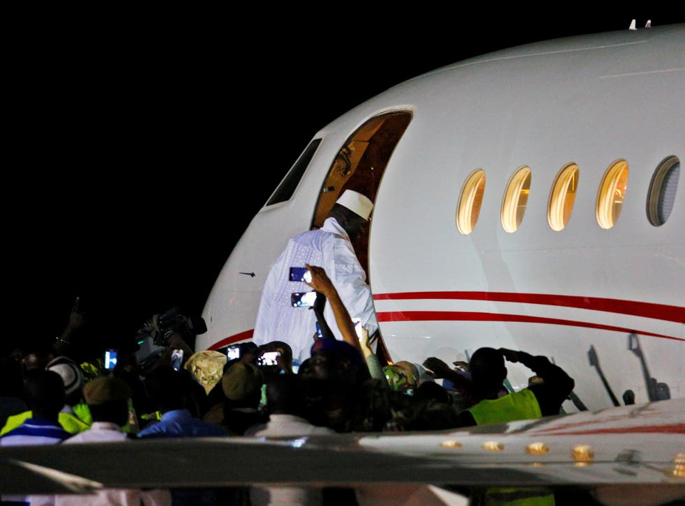Former Gambian president Yahya Jammeh boards a private jet before departing Banjul airport
