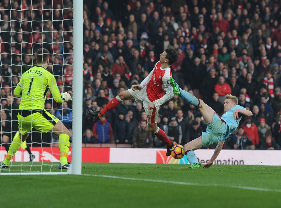 Laurent Koscielny was caught by a high foot from Ben Mee to win Arsenal a penalty despite being offside