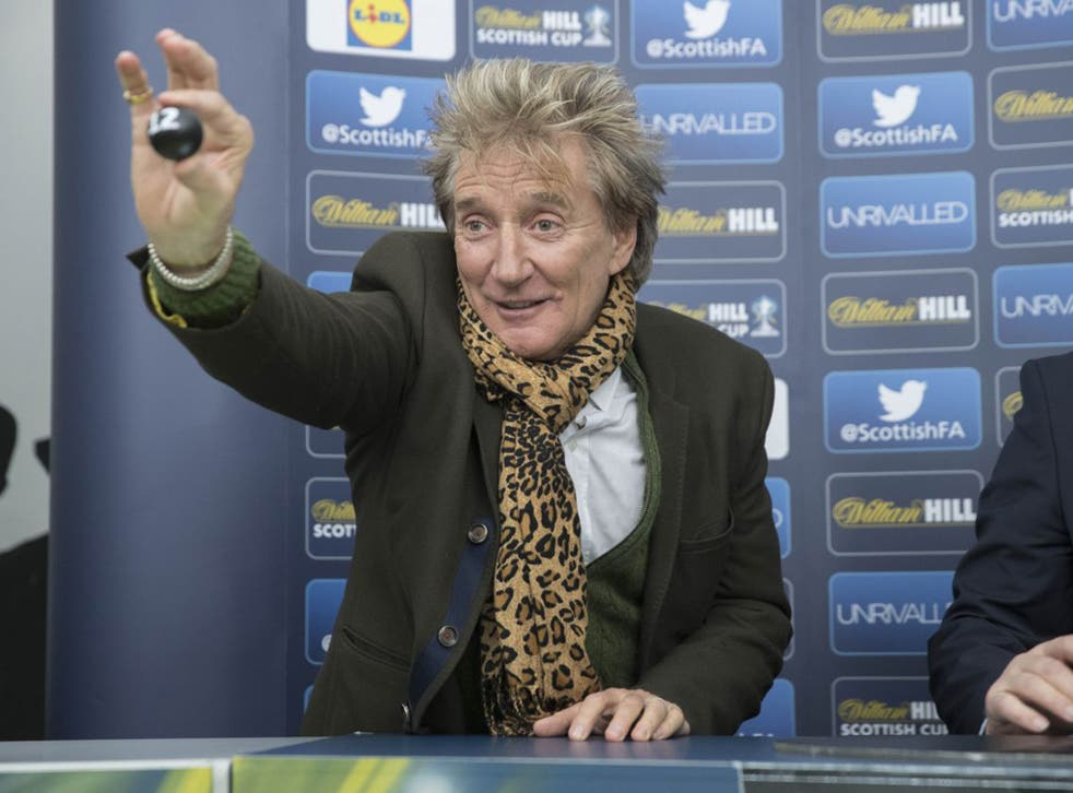 Sir Rod Stewart pulls out Rangers Ball during the William Hill Scottish Cup Fifth Round Cup Draw