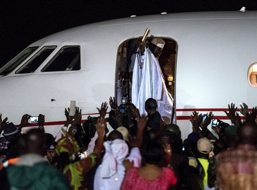 Ex-President Yahya Jammeh waves to a crowd of supporters before leaving the country on 21 January, 2017