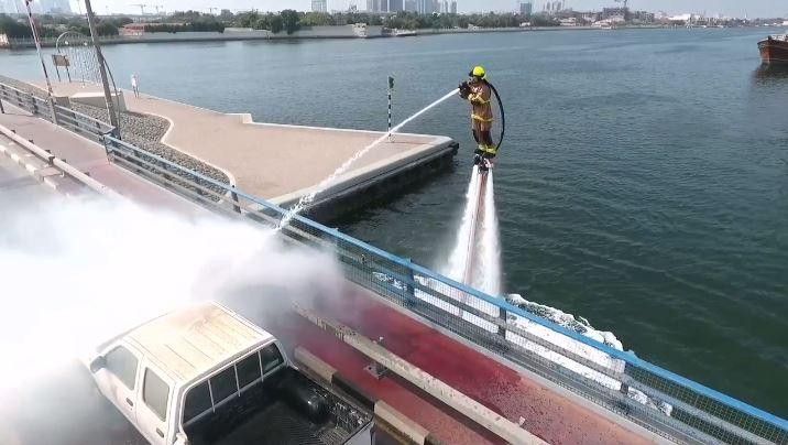 Dubai firefighters use water jetpacks to avoid city's heavy