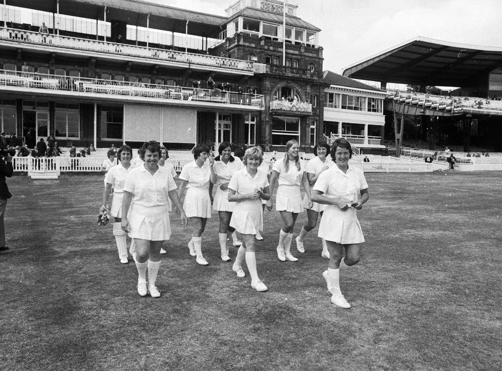 Rachel Heyhoe-Flint, the captain of the English Women's cricket team leads her team onto the pitch for the first ever women's cricket match to be played at Lord's