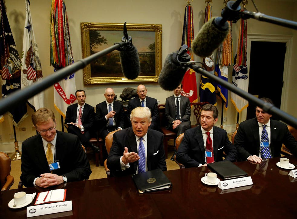 U.S. President Donald Trump hosts a meeting with business leaders in the Roosevelt Room of the White House in Washington January 23, 2017. From left are Corning CEO Wendell Weeks, Trump, Johnson & Johnson CEO Alex Gorsky and Dell CEO Michael Dell