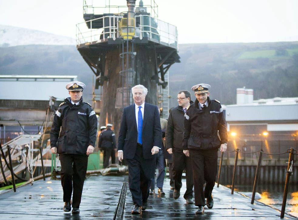 Sir Michael Fallon on board the HMS Vigilant in Clyde. The submarine is one of four vessels carrying the Trident nuclear system