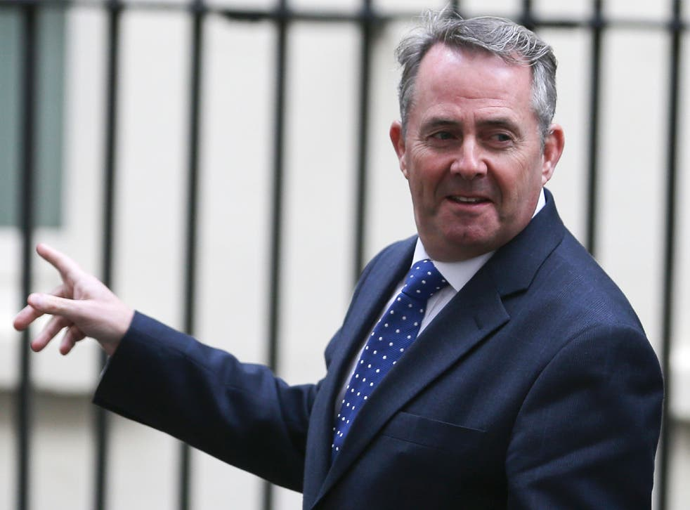 International Trade Secretary Liam Fox walks through Downing Street