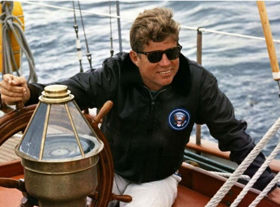 John F Kennedy sailing off the coast of Maine in 1962. The President sought to project a rugged image, without signs of weakness and emotion