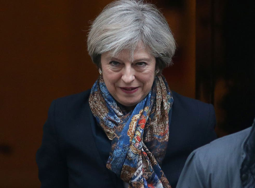 Prime Minister Theresa May leaves 10 Downing Street in central London on January 24, 2017.