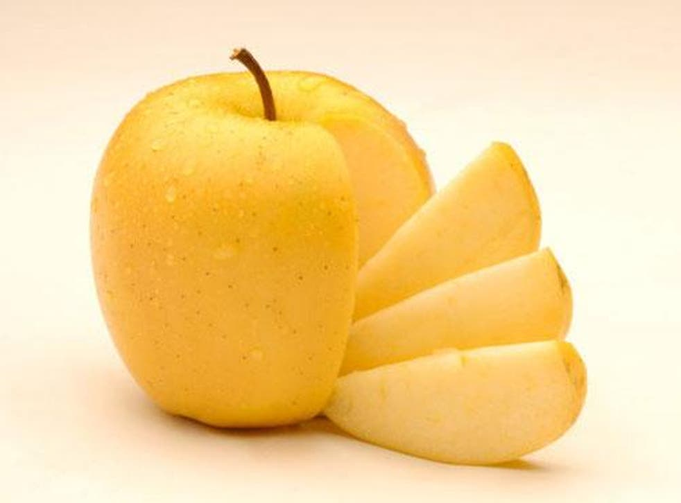 The genetically modified apple is scheduled to hit supermarket shelves as part of a 10-location trial next month