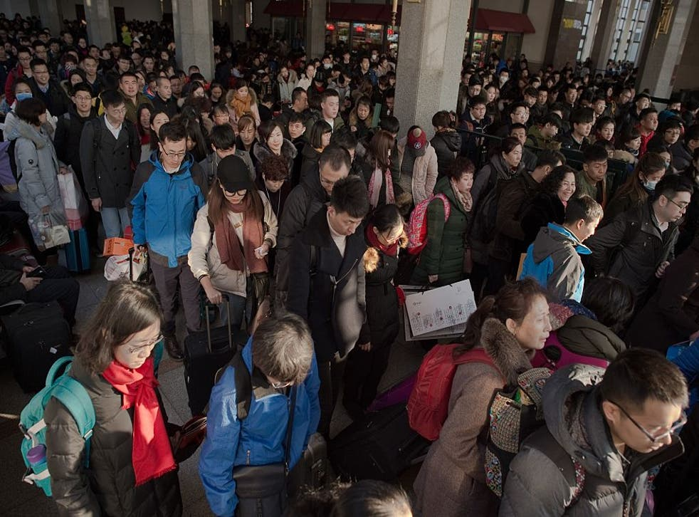 Passengers arrive at Beijing Railway Station to travel to their hometowns for the Lunar New Year on 24 January