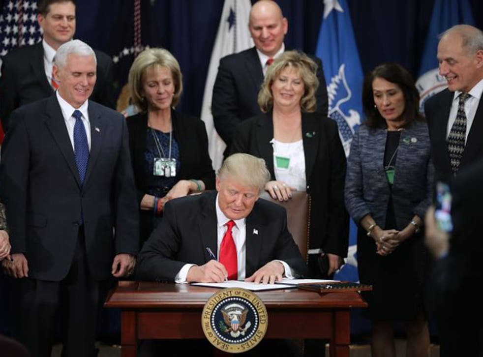 The US President signed a number of his most extreme immigration policies into law on Wednesday