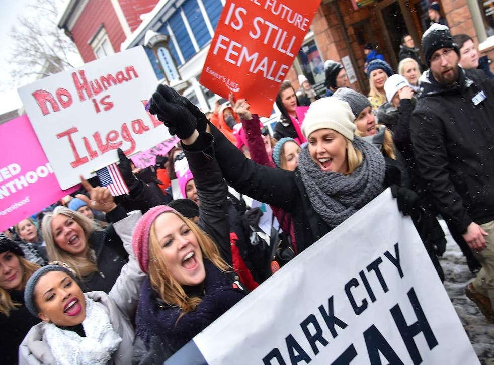 Charlize Theron poses during the Women's March on Main Street Park City on January 21, 2017 in Park City, Utah.