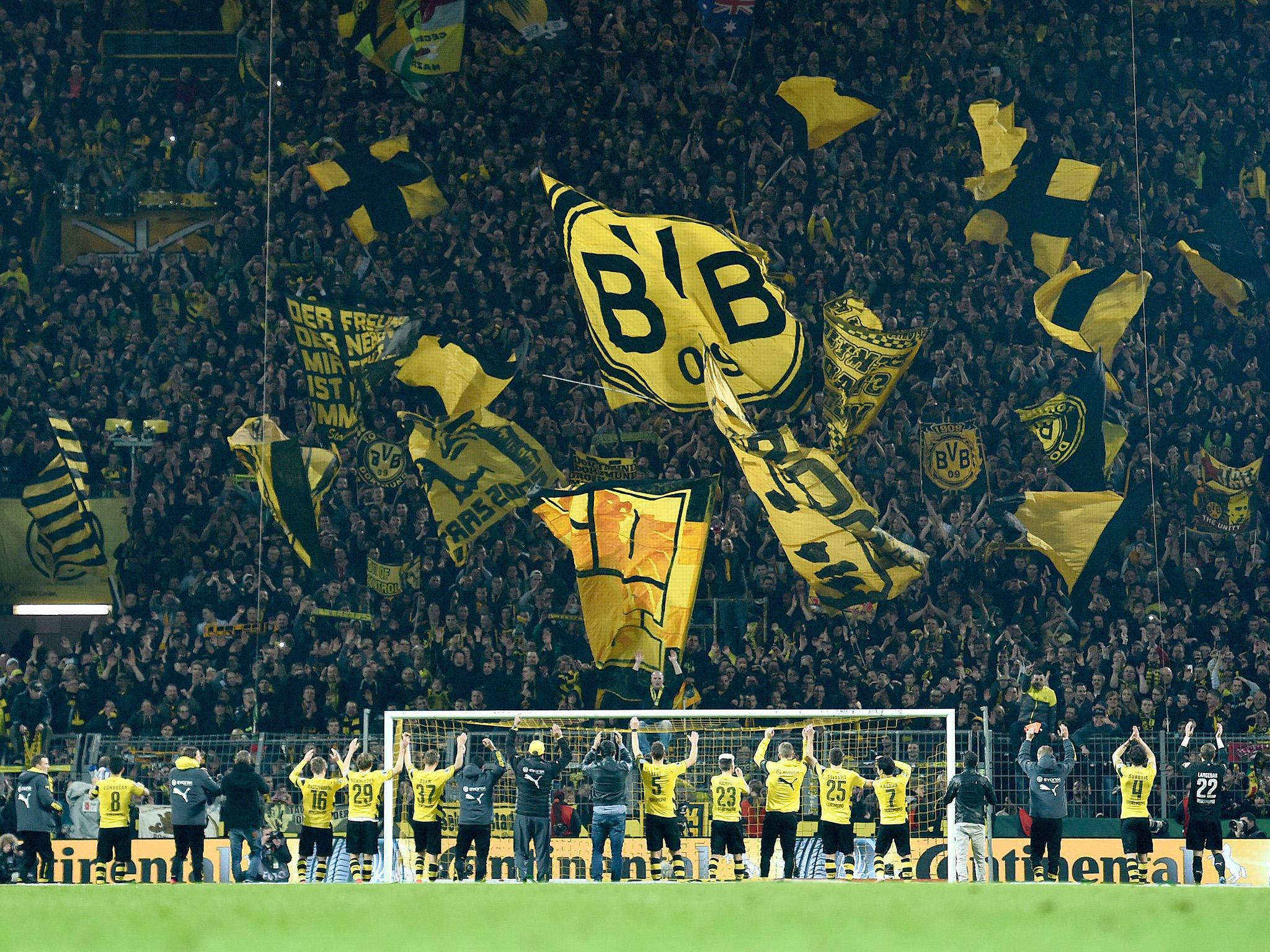 borrusia dortmund aim dig at donald trump with wall