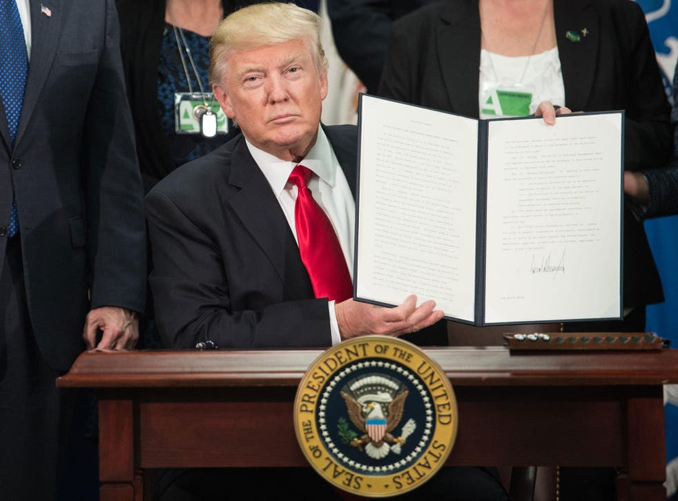 Donald Trump signs executive order to start Mexico border wall project