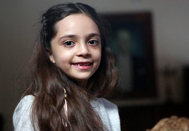 Syrian girl Bana al-Abed, known as Aleppo's tweeting girl, poses during an interview in Ankara, Turkey, on December 22, 2016